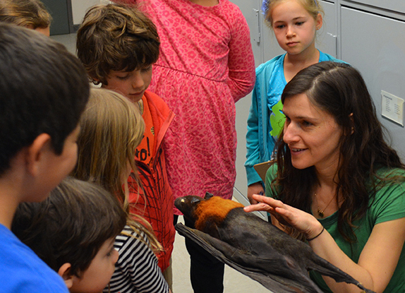 Professor Bree Rosenblum showing a specimen to students