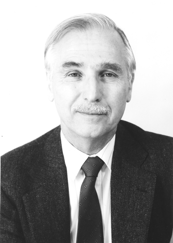 Black and white headshot of Dennis Teeguarden