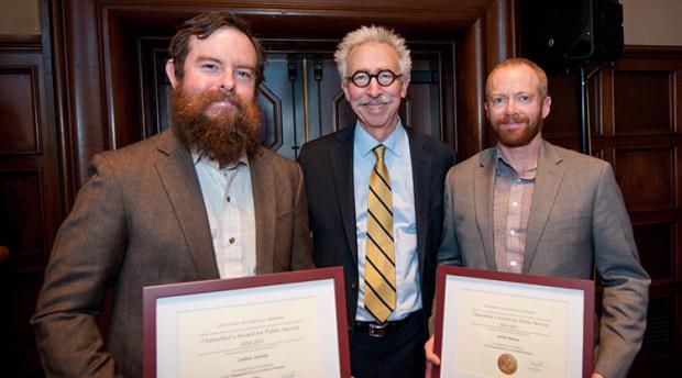 Joshua Arnold and Sarick Matzen pose with the Berkeley Chancellor.