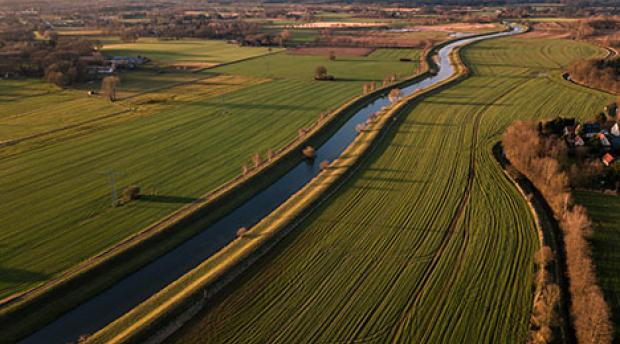 Water running through agricultural lands.