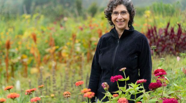 Claire Kremen in a field