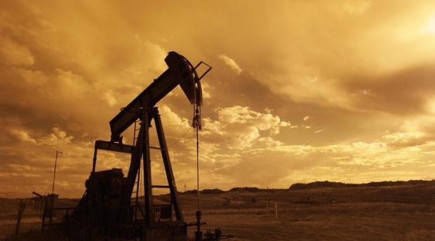 Oil pump jack with sunset