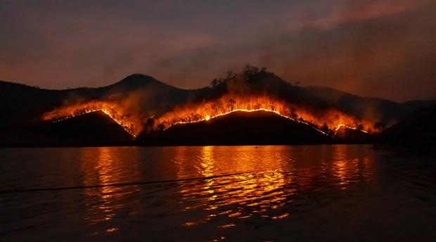 Wildfire on a mountain in the dark