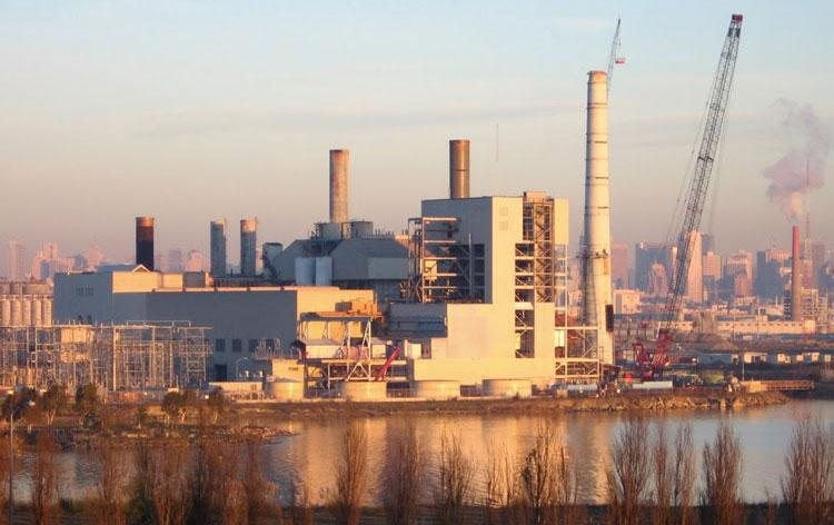 Landscape of a coal plant at sunset