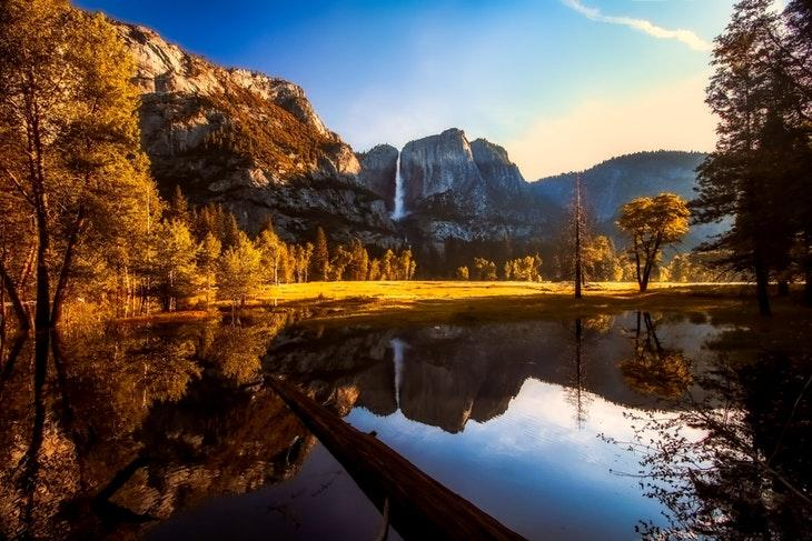 Landscape of Yosemite Valley with waterfall and lake