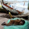 A child grabs sleep wherever possible after a long day of labor in West Africa's struggling fishery.
