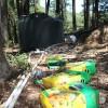Discarded fertilizer boxes near a covert marijuana field.